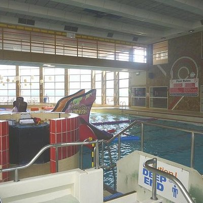 Standing by the slide and behind the wave machine tower looking towards the shallow end.