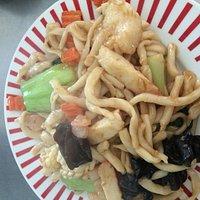 Stir fried seafood with handmade noodle