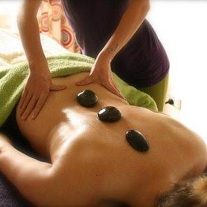 Hot Stone Massage - The stones become a extension of the therapist hands.