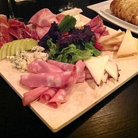 Charcuterie and cheese platter served with sliced bread