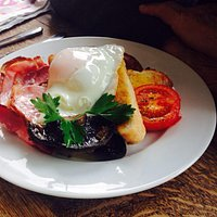 Full English Breakfast, Old Spot Sausage, Portobello mushroom, smoked bacon, toast and free-rang