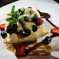 Mixed berries with warm zabaion in a puff basket