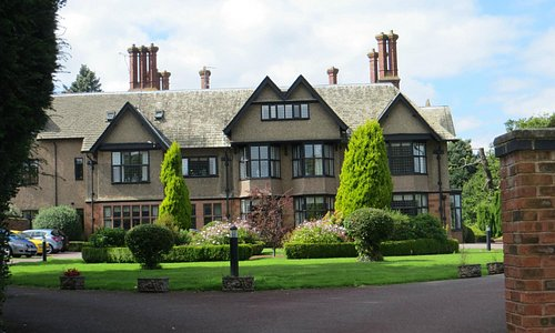 Formerly Allesley Hall, now a care facility at park's centre