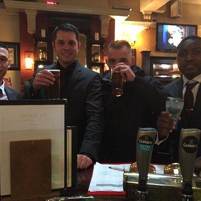 Enjoying a pint with friends.