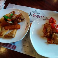 Food from the buffet on the left, food from the wok on the right.