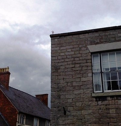 Can you spot the little man on the roof?