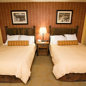 The Double Queen Room with Balcony Overlooking Stream at the Old Creek Lodge