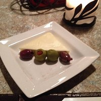 Butter and olives served with fresh bread