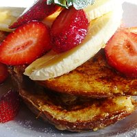 French toast with banana strawberry maple syrup and marscapone