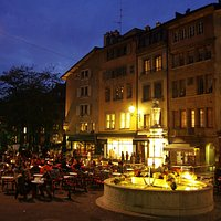 Place Bourg du Four at night