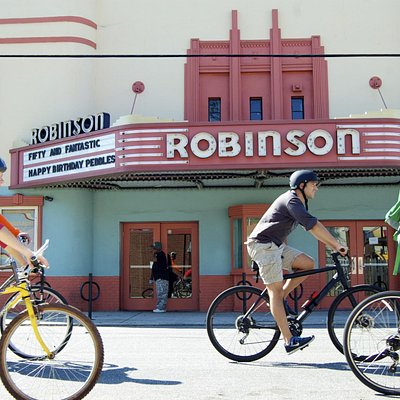 Riding past the Robinson Theater