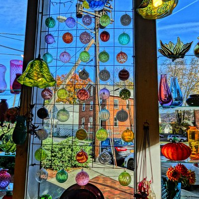 Window full of sample ornaments.
