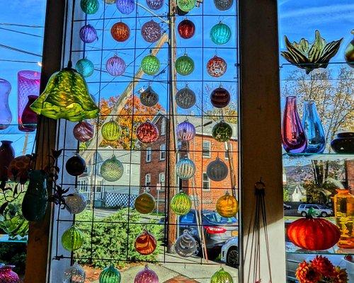 Window full of sample ornaments.