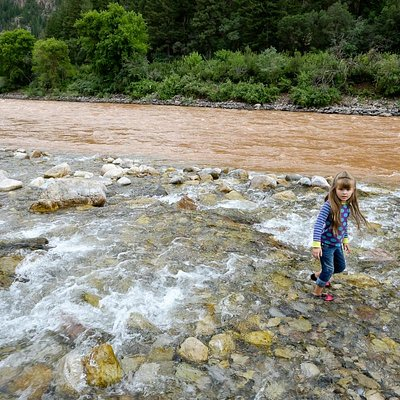 Clear Grizzly Creek meets the muddy Colorado River