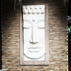 Buddha facing the road at front of the spa