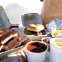 Full rack of ribs, pulled pork sandwich, chili, wild sauce, slaw, hot cashews and cornbread.