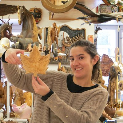 Sandra shows off my maple leaf in the shop