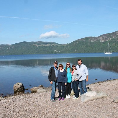 A party of happy visitors by Loch Ness near Dores
