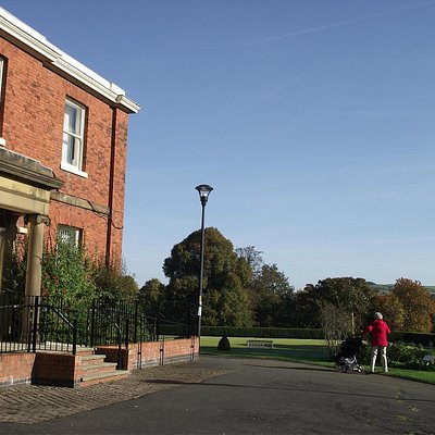The council offices in the former estate house with the bowling green and the hills beyond.