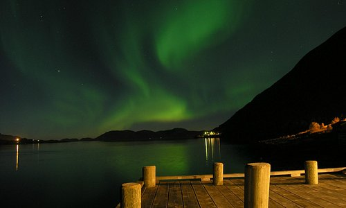Northern lights in front the cabins