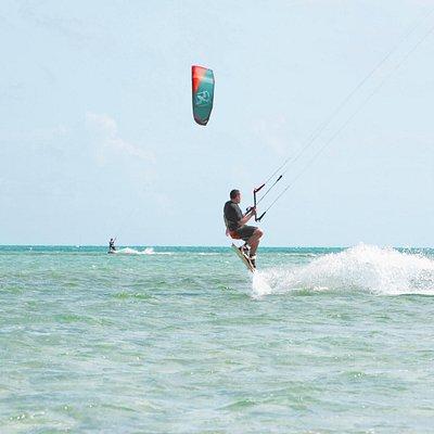 cross-shore kiteboarding school south beach nassau bahamas kitesurfer jumping