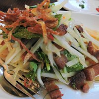 Salad of crisp braised pork belly with green papaya mint kaffir lime leaves fried shallots & lim