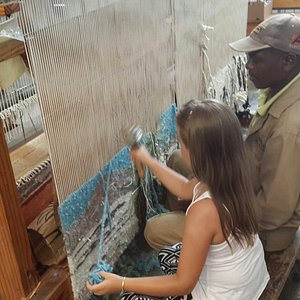 My daughter being given the chance to weave.