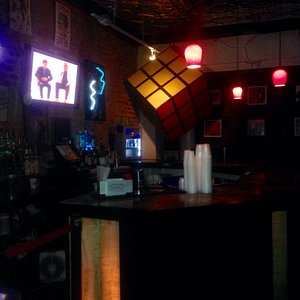 Huge hanging rubic cube by the bar