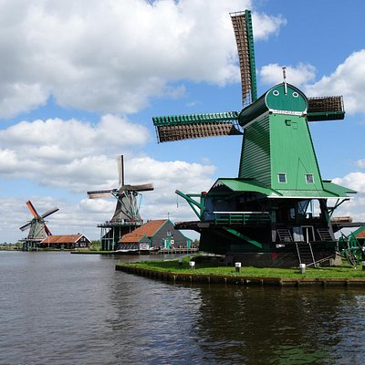 Windmills on the bank of the river.