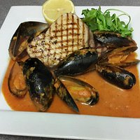 Grilled swordfish with mussels in a creamy napoli sambucca sauce