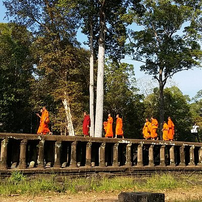 Monks walking on Baphuon's causeway