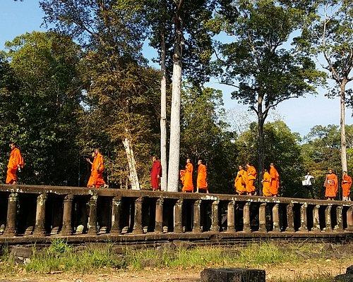Monks walking on Baphuon's causeway