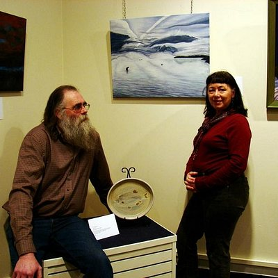 Local artists, Kirk and Veronica, with some of their work on display at an art show at the museu