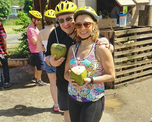 Enjoying coconut water at the top of the hill