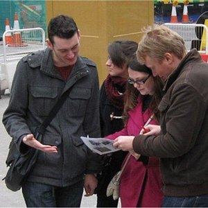 Treasure Hunts in London adventurers discussing clues at Liverpool Street