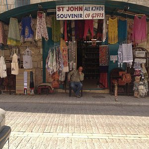 The owner outside of his shop, which is a few doors down from StarBucks of Bethlehem