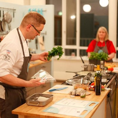 Chef at the chefs table, demonstrating a skill