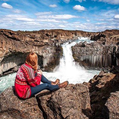 A women enjoys the view on Aldeyjarfoss