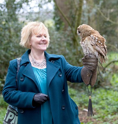 A guest enjoying flying Sage, the Tawny Owl.