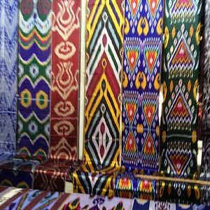 bold Uzbek designs and colors at Kumtepa Bazaar, Margilon Uzbekistan