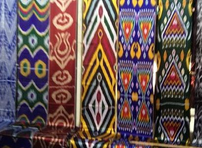 bold Uzbek designs and colors at Kumtepa Bazaar, Margilon Uzbekistan