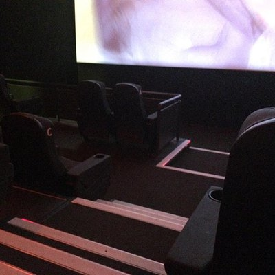 Image of wheelchair space in one the cinemas. Uncomfortably close to the screen