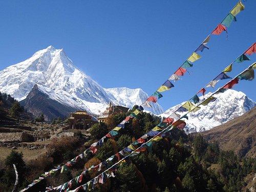 Mount Manaslu and Buddhist Monastery in Nepal.