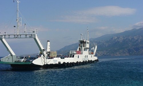 The ferry about to dock at Zigljen (Pag) on a beautiful June morning: the mainland on the backgr