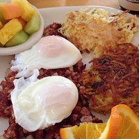 Delicious corned beef hash with farm fresh poached eggs done to perfection.