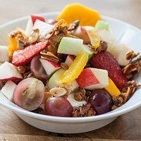 Home made granola with yogurt and fresh fruit
