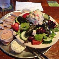 Greek Salad with potato salad, hummus, and stuffed grape leaves.