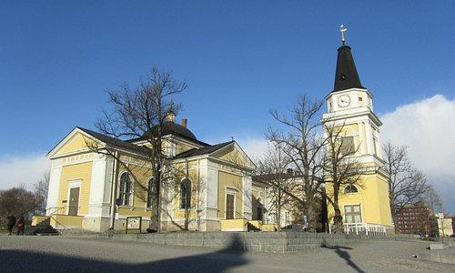 Beautiful church and bell tower beside Keskustori