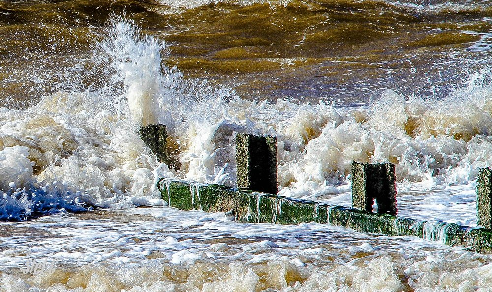A Groyne dealing with a ferocious tide in high winds.