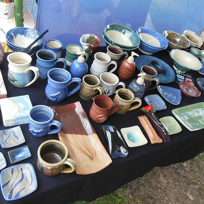Hand made pottery is offered at this market by artists